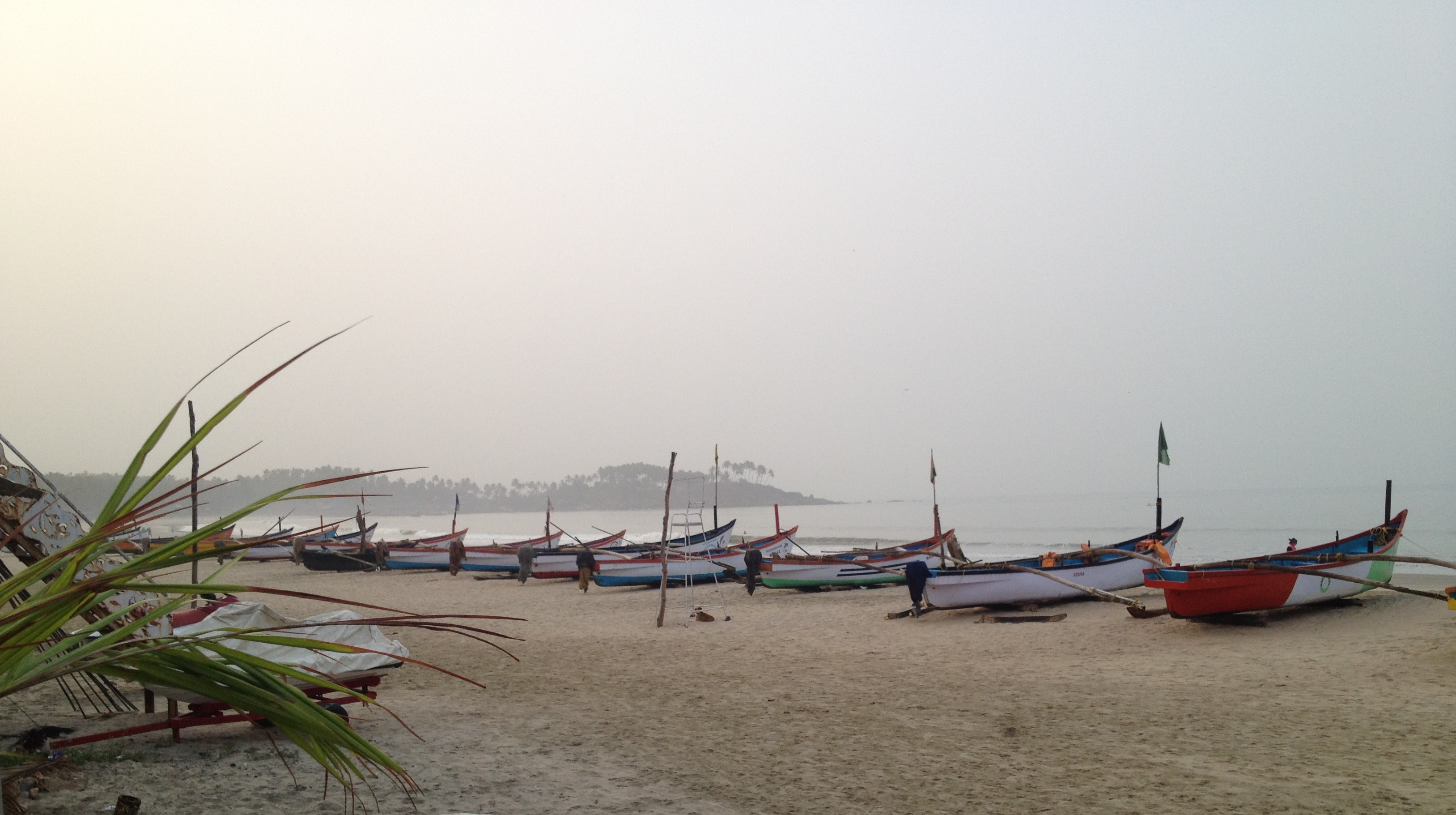 boats lined up on palolem beach goa